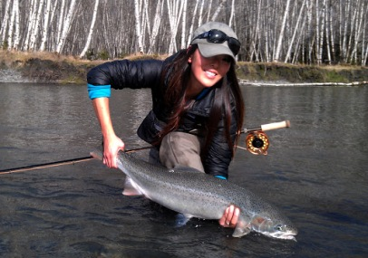 Lisa with a wild steelhead on one of her favorite rivers in the PNW